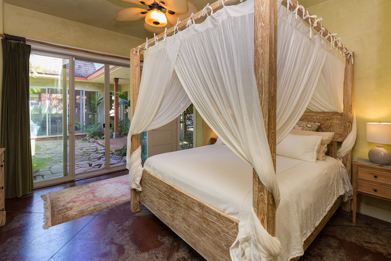 the master suite opens up to the exterior courtyard