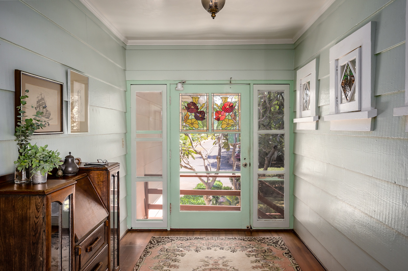 Classic fixtures and stainclass windows and accents contribute to the old home charm of 461 Laulea.